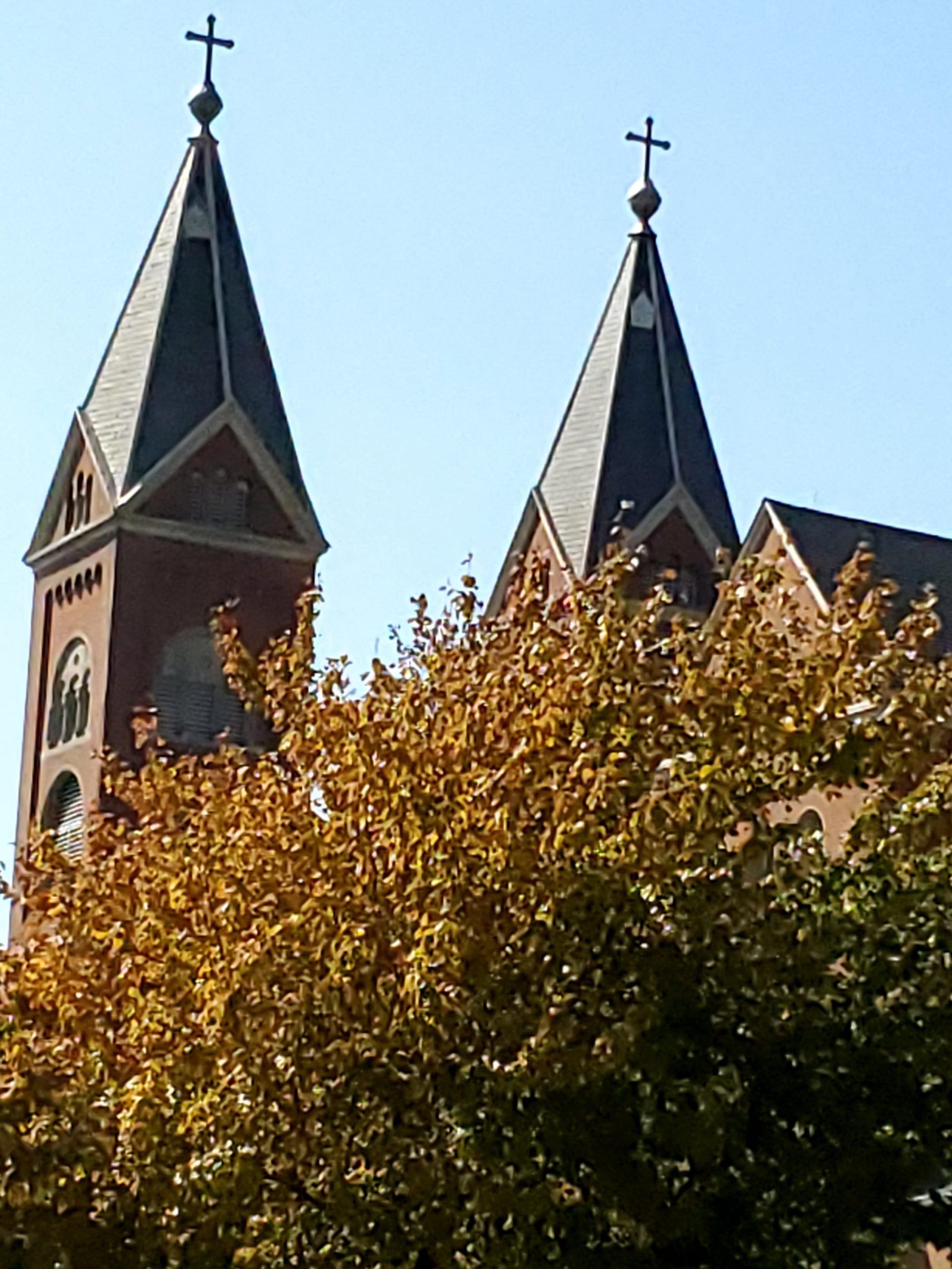 "JEANNINE WYATT, FAITH AND HOPE....ALWAYS WITH ME, ALWAYS ENDURING: I submitted a recent photograph I took following the funeral of a friend who died of leukemia. This friend was a Benedictine monk. As I left the abbey, I looked to my left and noticed the twin steeples of the nearby local parish church. I pulled over and sat in my car and gazed at the steeples and crosses against the cerulean blue sky. I could not help but think of my own cancer, the MDS that fatigues me with the anemia I have. I was very tired that afternoon. But my thoughts as I looked at the crosses atop the twin steeples were of ""Faith and Hope…. Always With Me, Always Enduring""."